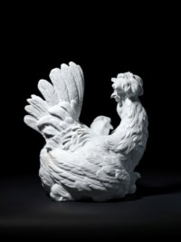 A MEISSEN WHITE PORCELAIN MODEL OF A HEN WITH HER CHICKS